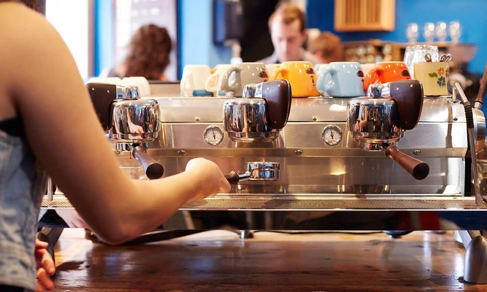 Barista using an espresso machine