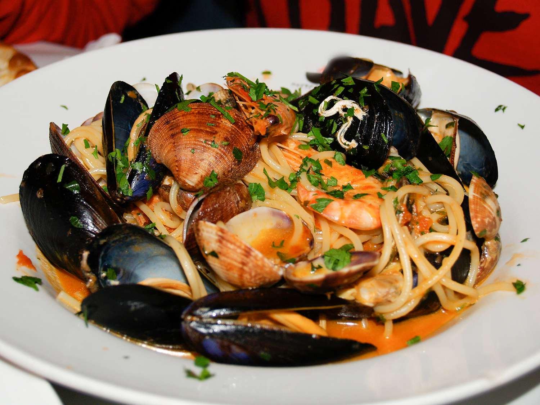 Spaghetti frutti di mare, seafood pasta in a white bowl