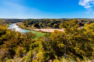 View of the Texas Pedernales River from a High Bluff, with Fall Foliage.