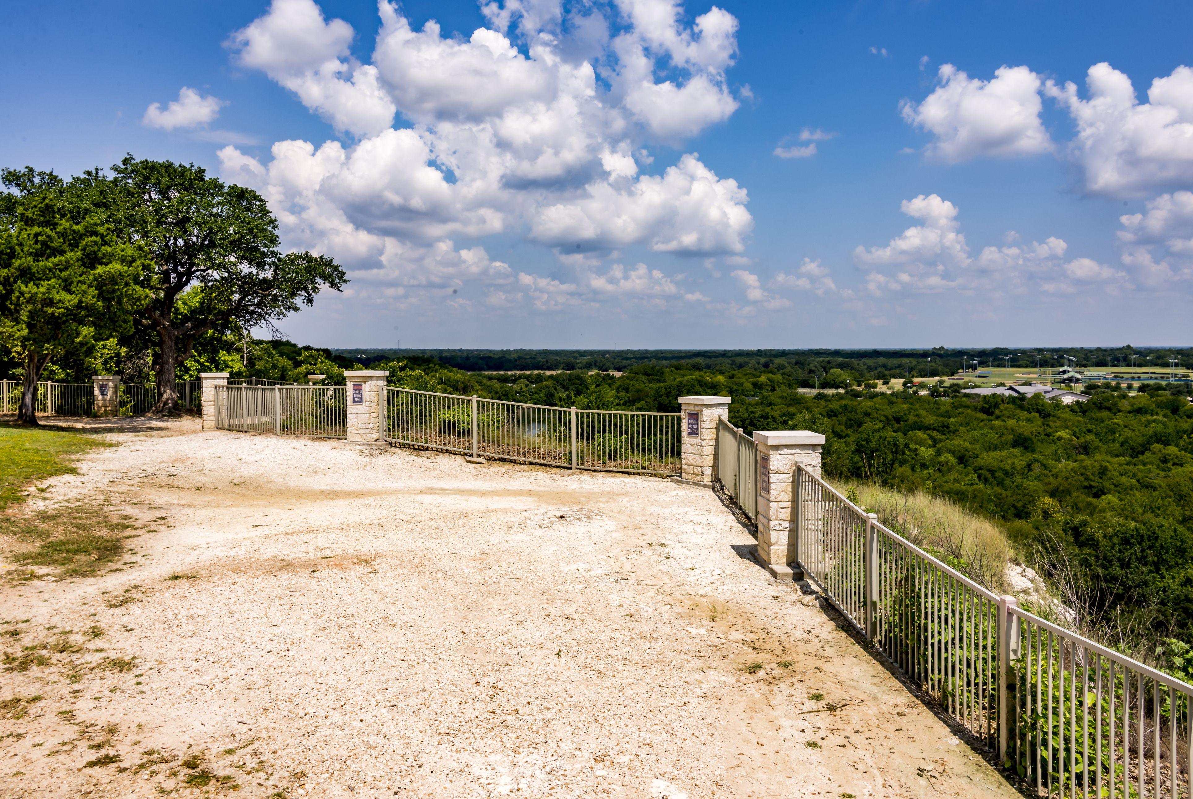 Waco, Texas, USA - Aug 4, 2017: The view from Emmons Cliff overlooking the Brazos River and Texas Hill Country beyond.