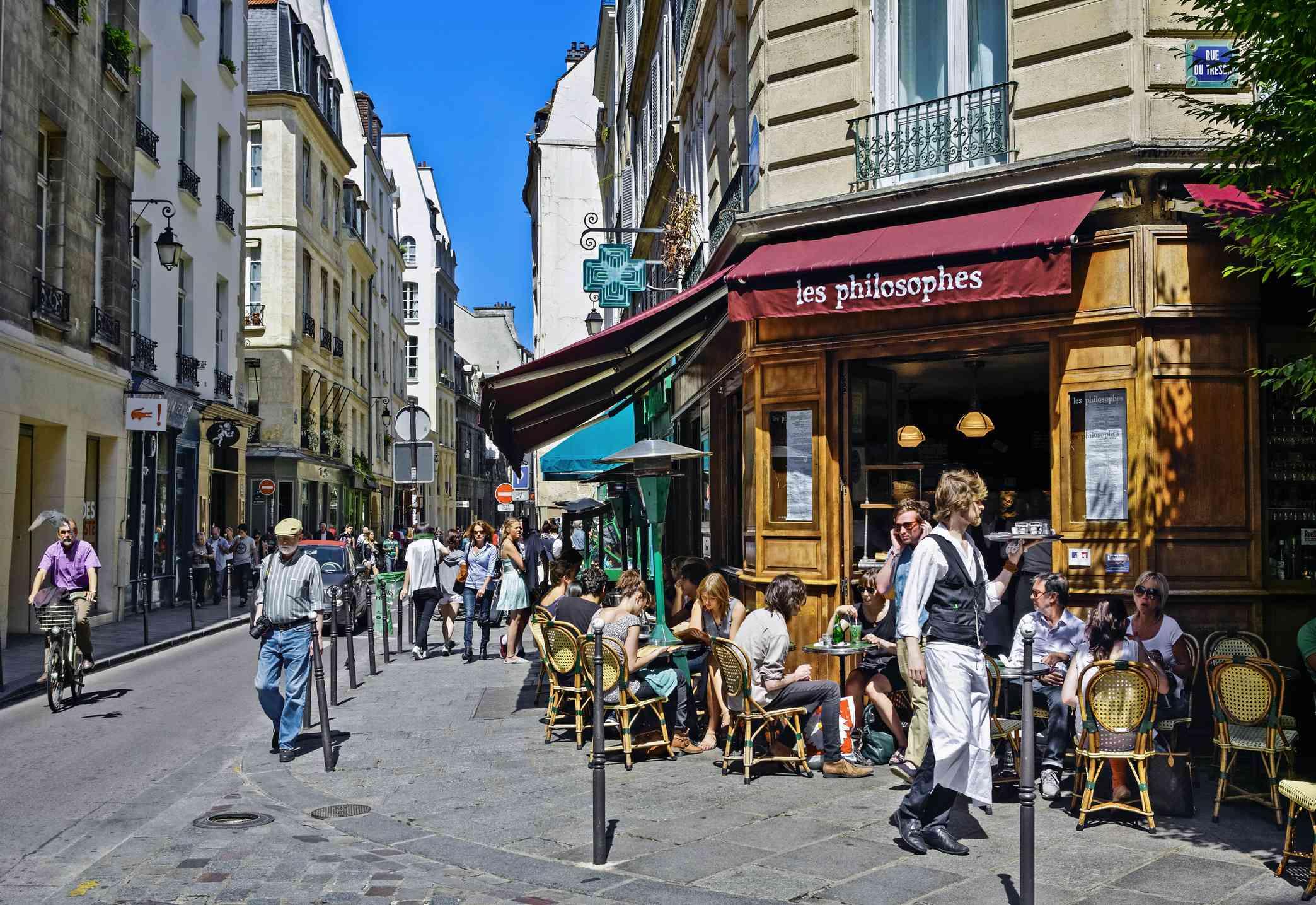 Café terrace and street in Marais, Paris