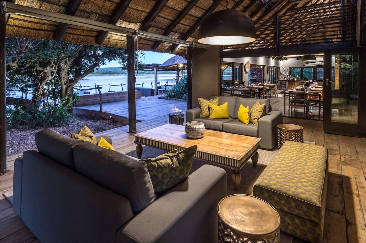 Couches and tables in the main lodge at Kariega Game Reserve