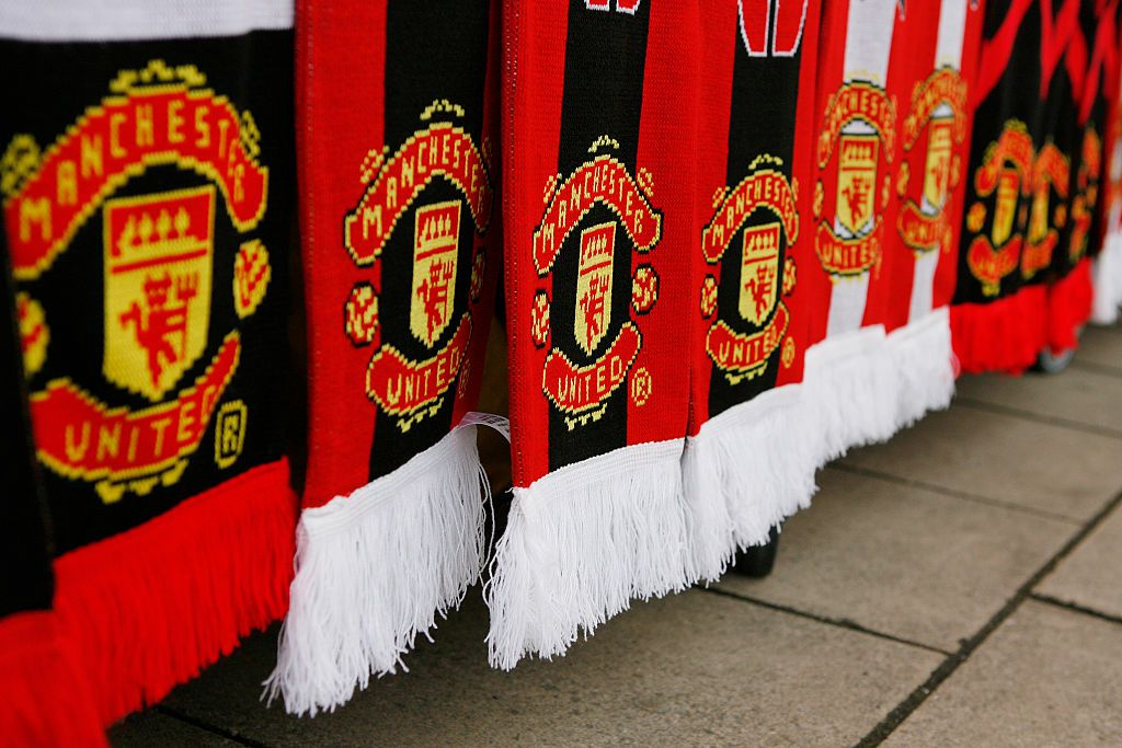 Manchester United scarves hanging on table