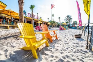 Colorful beach chairs on the beach on a sunny day