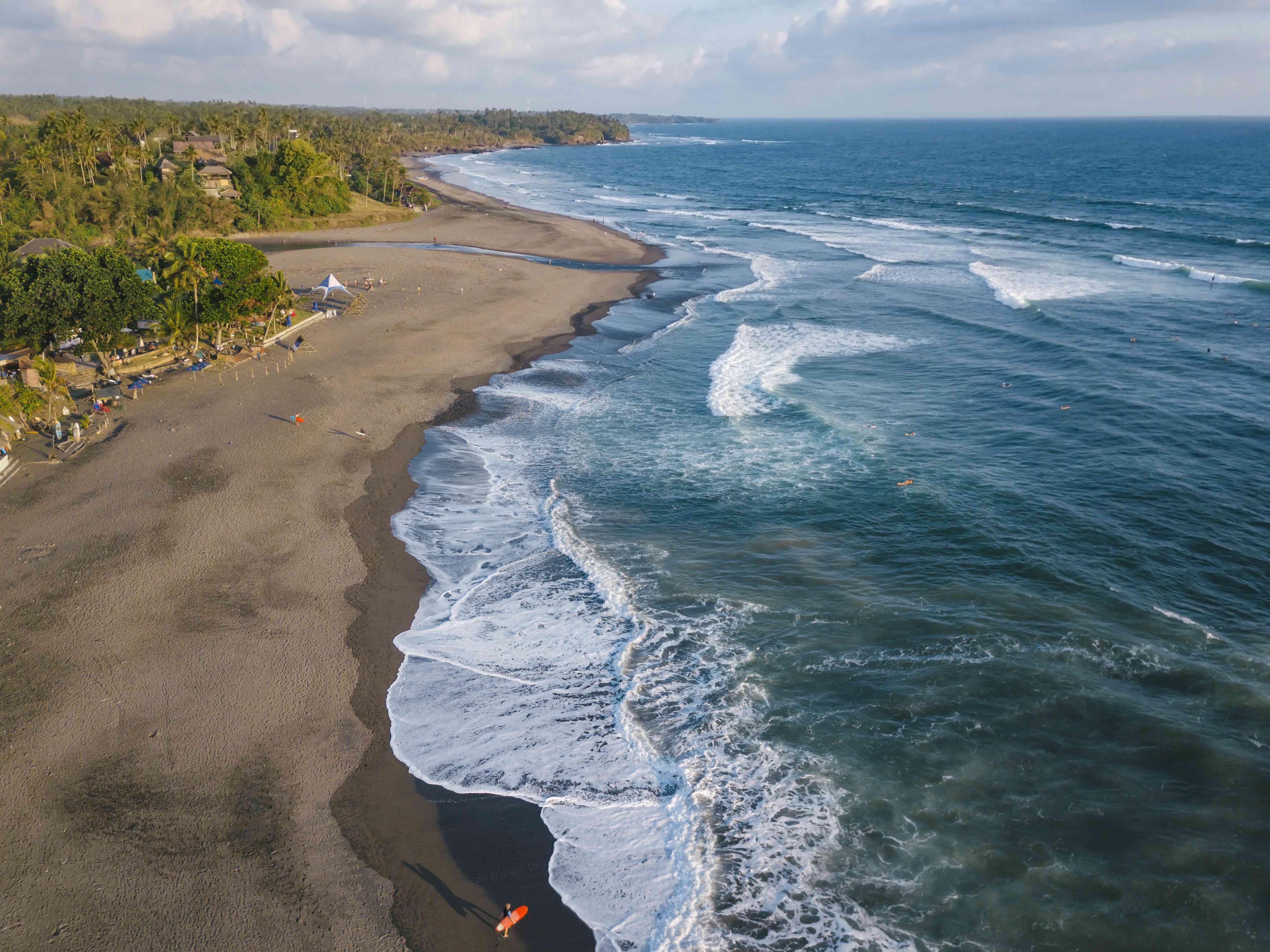 Indonesia, Bali, Aerial view of surfers at Balian beach
