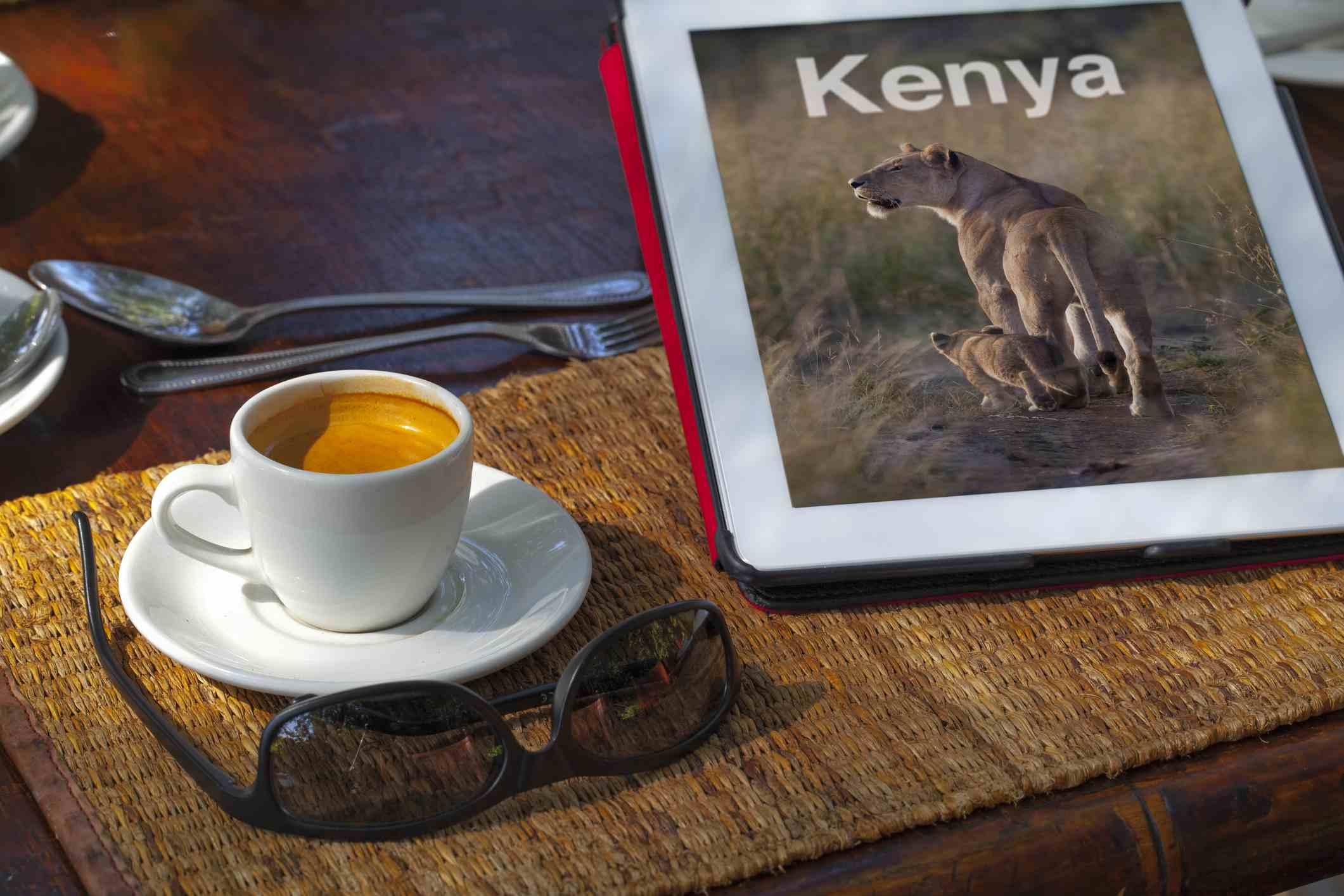 A digital travel guide beside an espresso
