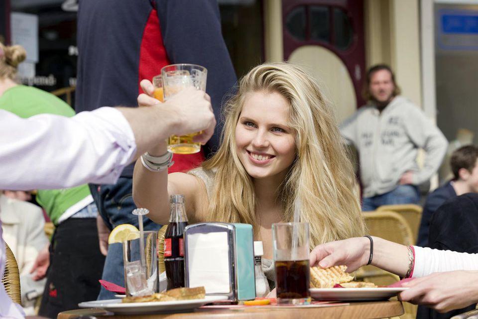 Amsterdam tourist on terrace drinking