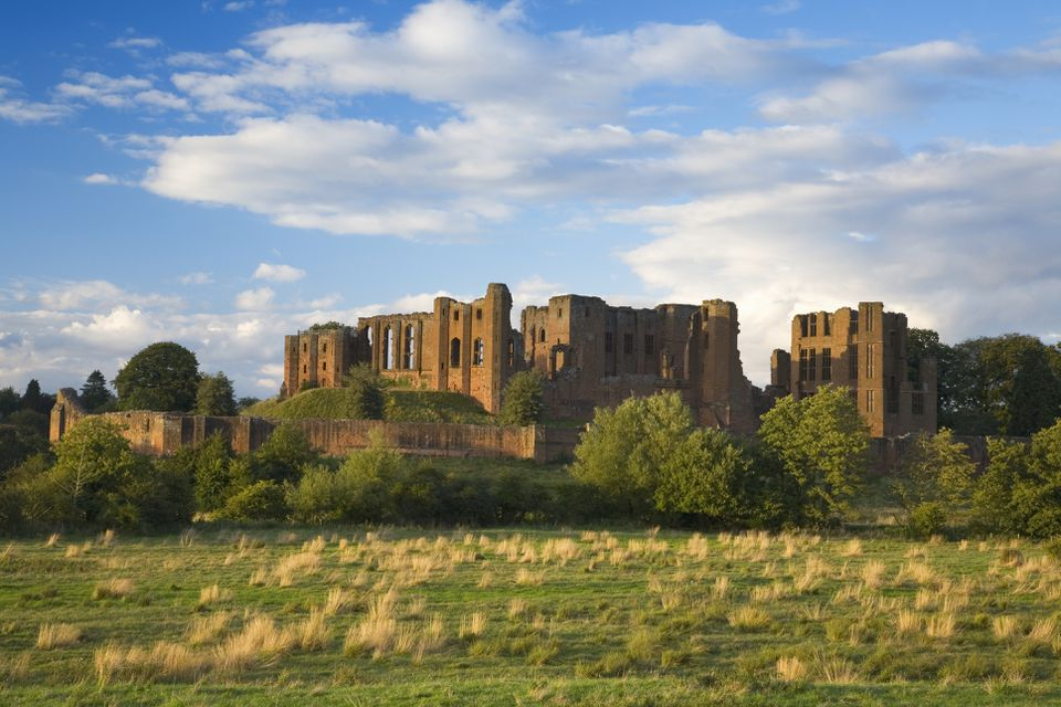 A view across a field to Kenilworth Castle in Warwickshire.