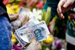 a Chinese merchant handing money to a customer