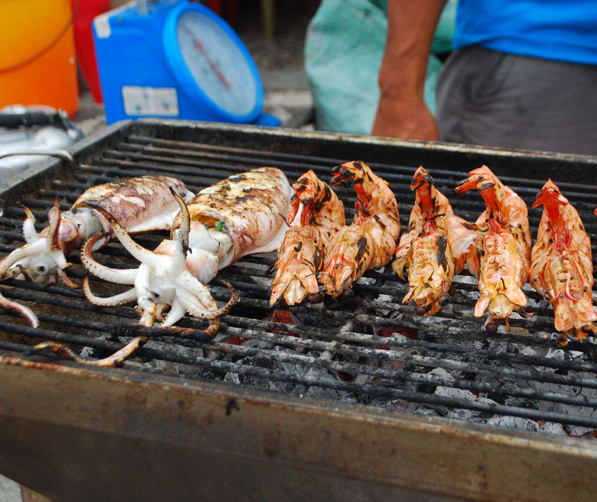 """Squid and prawn undergoing the """"sutukil"""" treatment."""