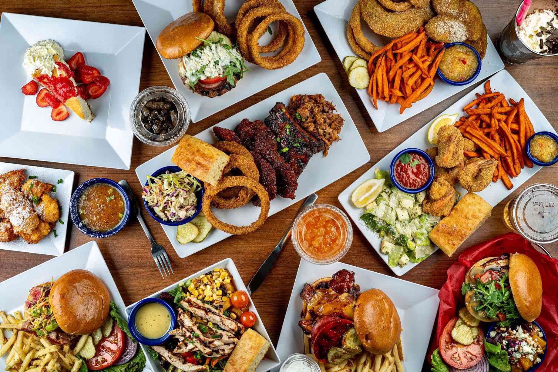 A birds eye view of a table filled with different foods