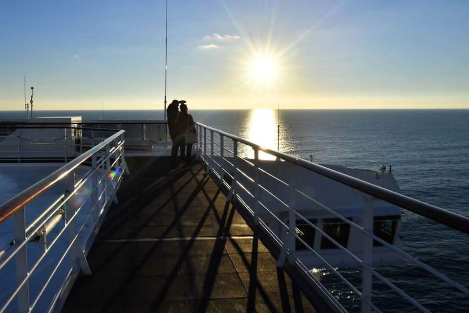 People on cruise ship watching sunset