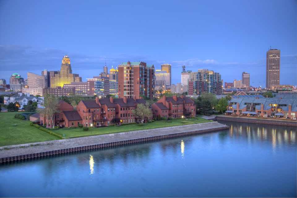 Downtown Buffalo skyline along the historic waterfront district at night.