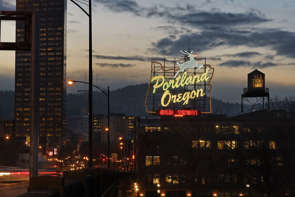 Dusk shot of Portland Oregon neon sign, city
