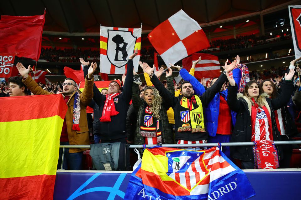 Club Atletico de Madrid fans support their team during the UEFA Champions League in Madrid