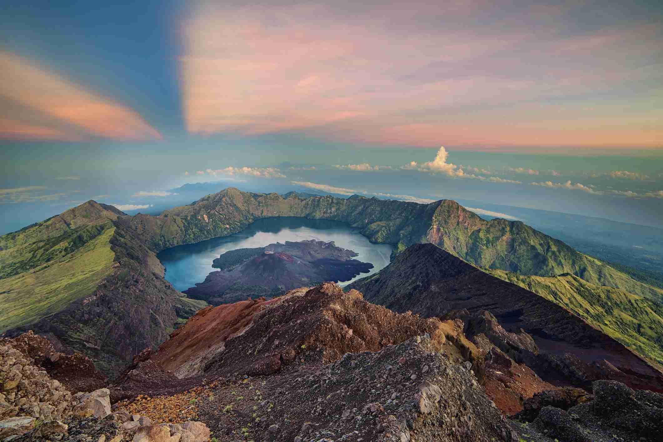 The volcanic crater of Gunung Rinjani during sunrise