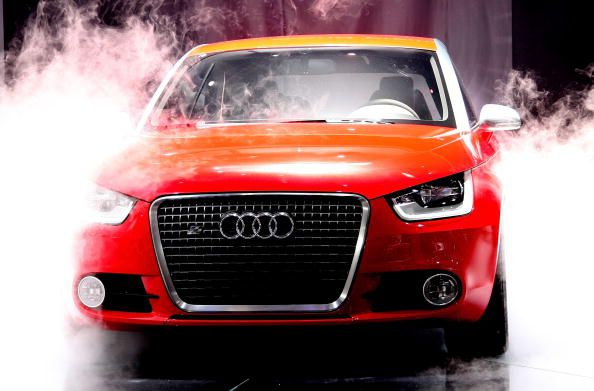 Red Audi in cloud of steam