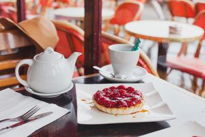 Tea and pastry on a table at café in Paris