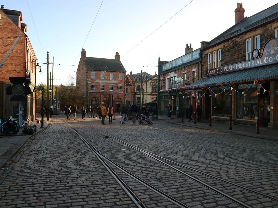 20th century English town with a brick road with street car tracks