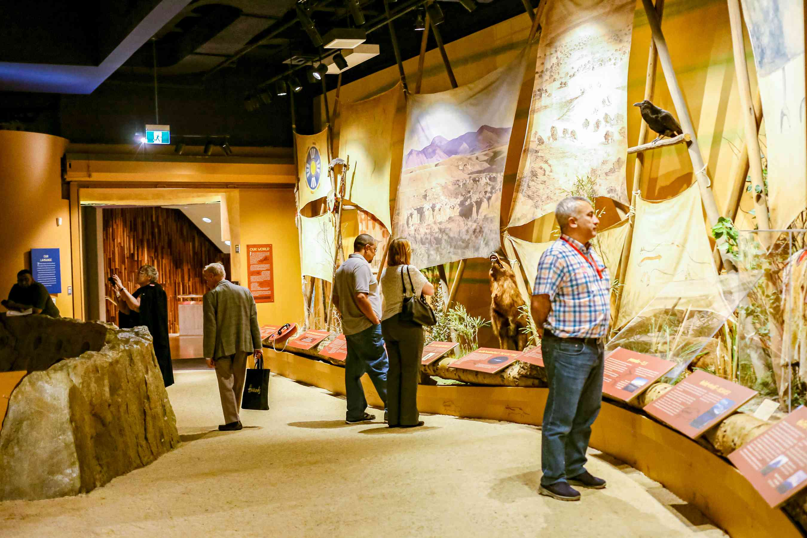 People observing an exhibit in the Glenbow Museum