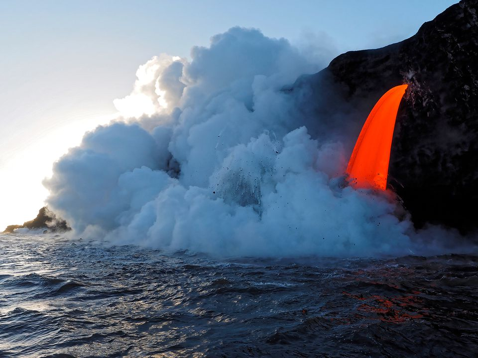 Lava from Puu Oo flowing into ocean on Kalapana Coast, Hawaii Volcanoes National Park, Big Island, Hawaii, USA