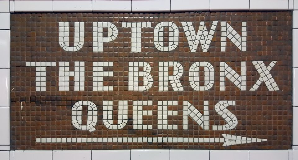 Mosaic directing passengers in direction: Uptown - The Bronx - Queens