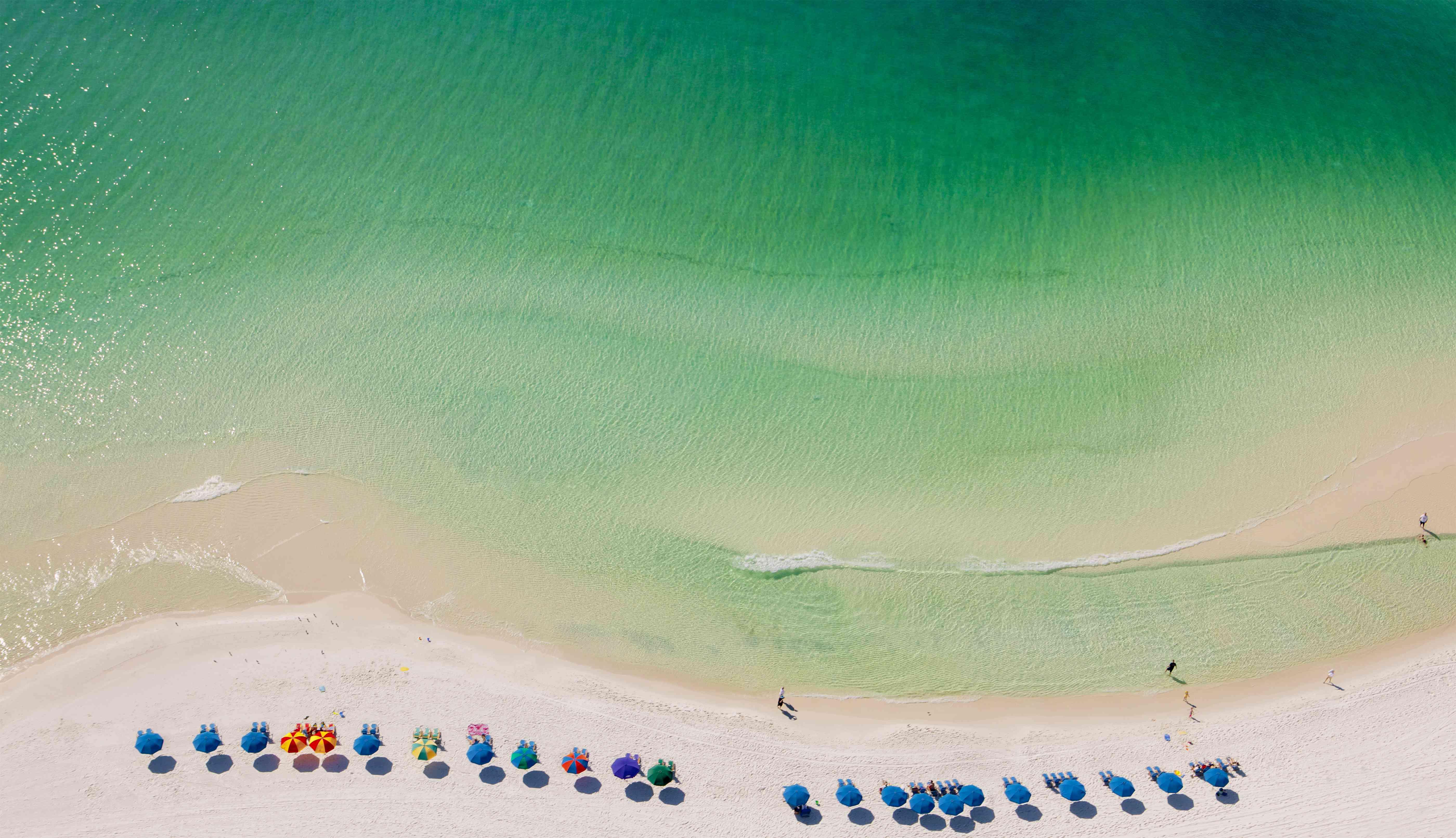 Beach umbrellas on beach, Destin, Florida, USA