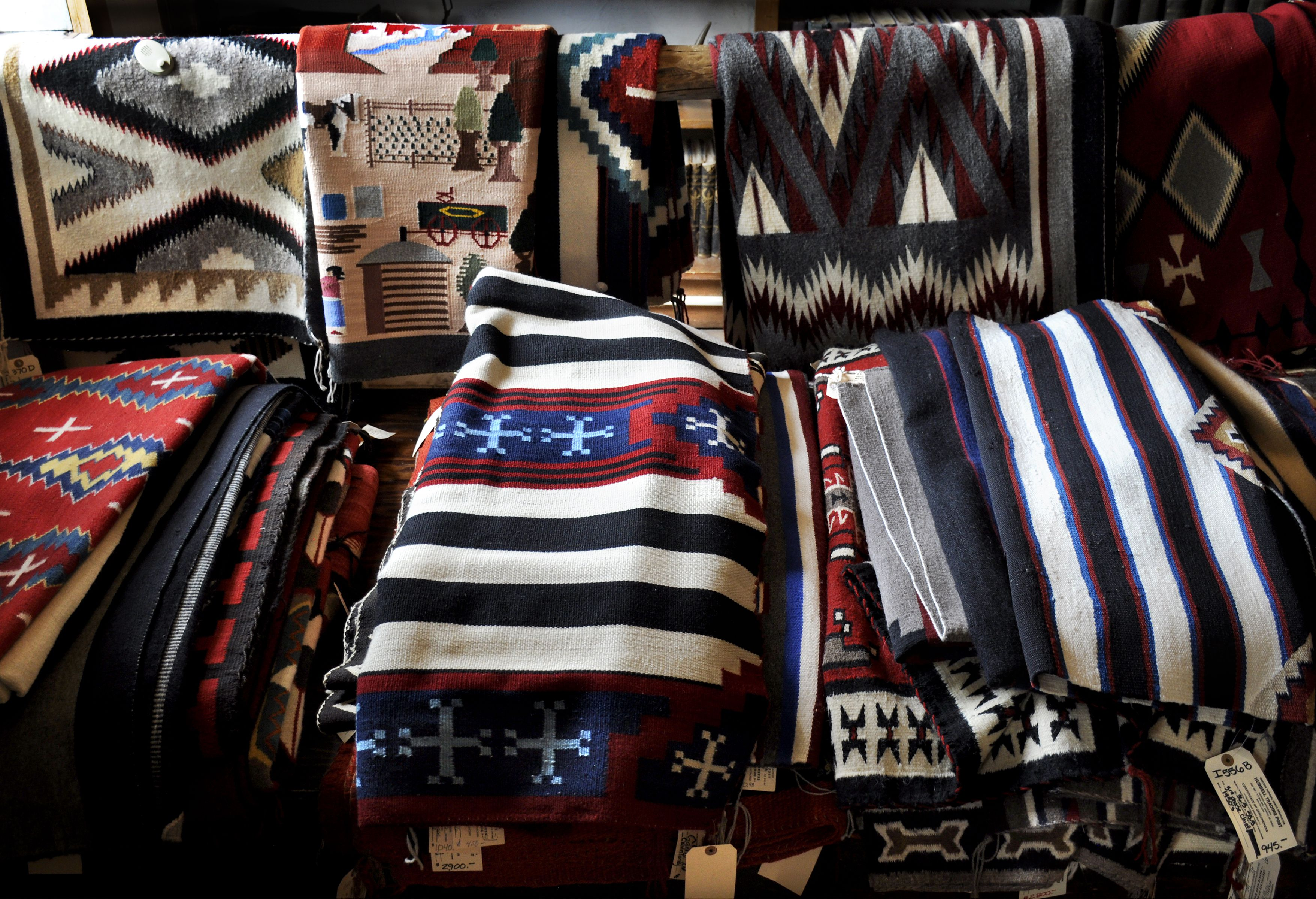 A selection of handmade Navajo wool rugs is among the Native American items for sale at the Hubbell Trading Post National Historic Site near Ganado in eastern Arizona.