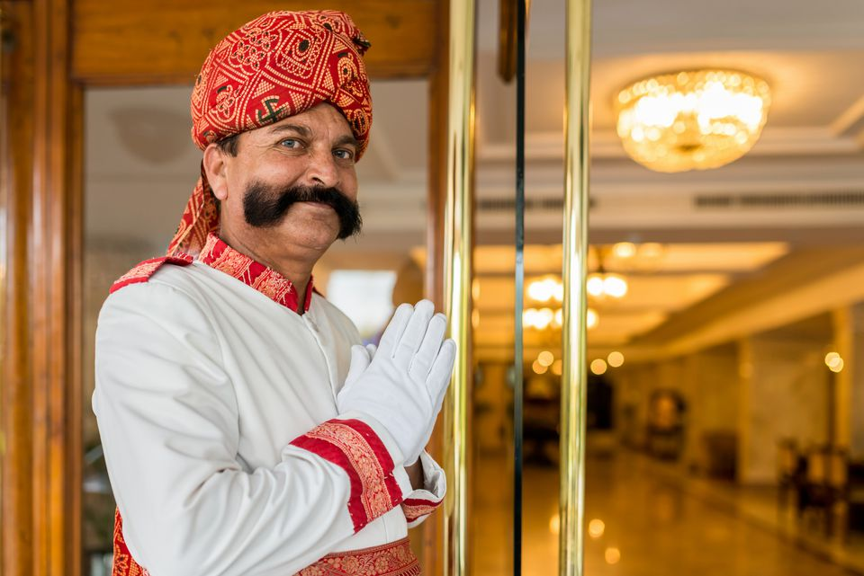 Indian Concierge Welcome Guest at Hotel Entrance India