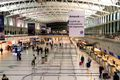 Passengers check in at the desks of the Ezeiza International Airport in the central hall of terminal A