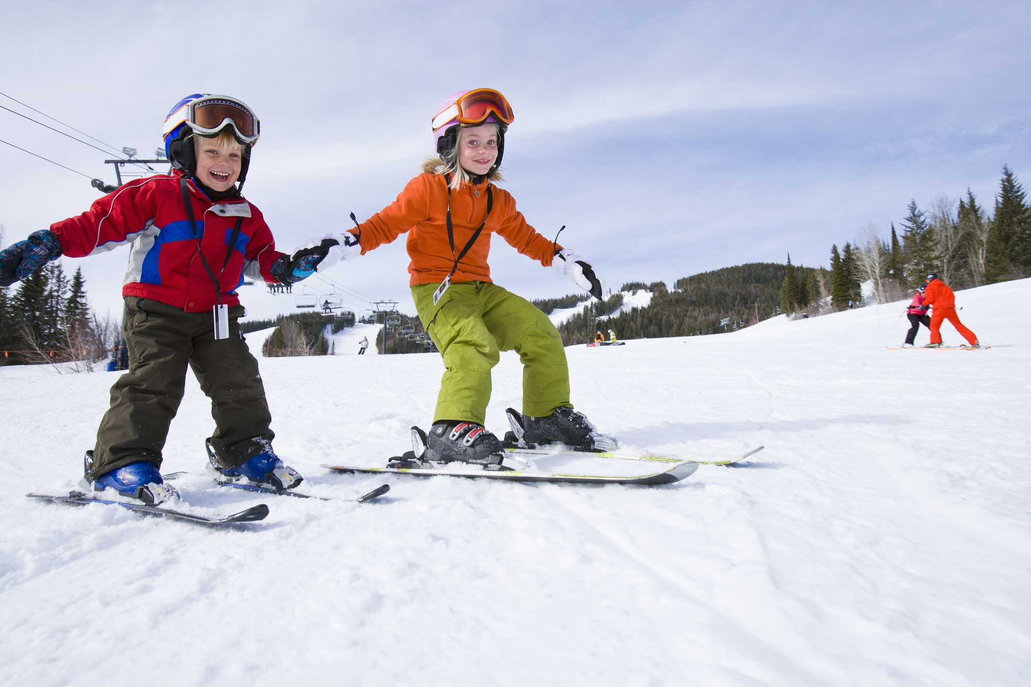 Two kids skiing
