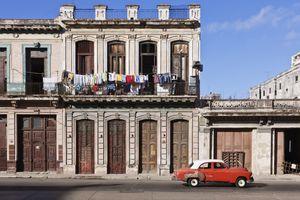 Vintage car driving on Havana street, Havana, Cuba