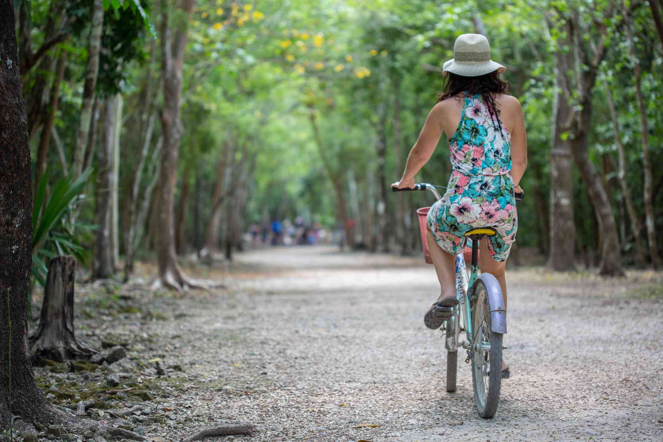 Woman Riding a Bicycle near Tulum, Mexico