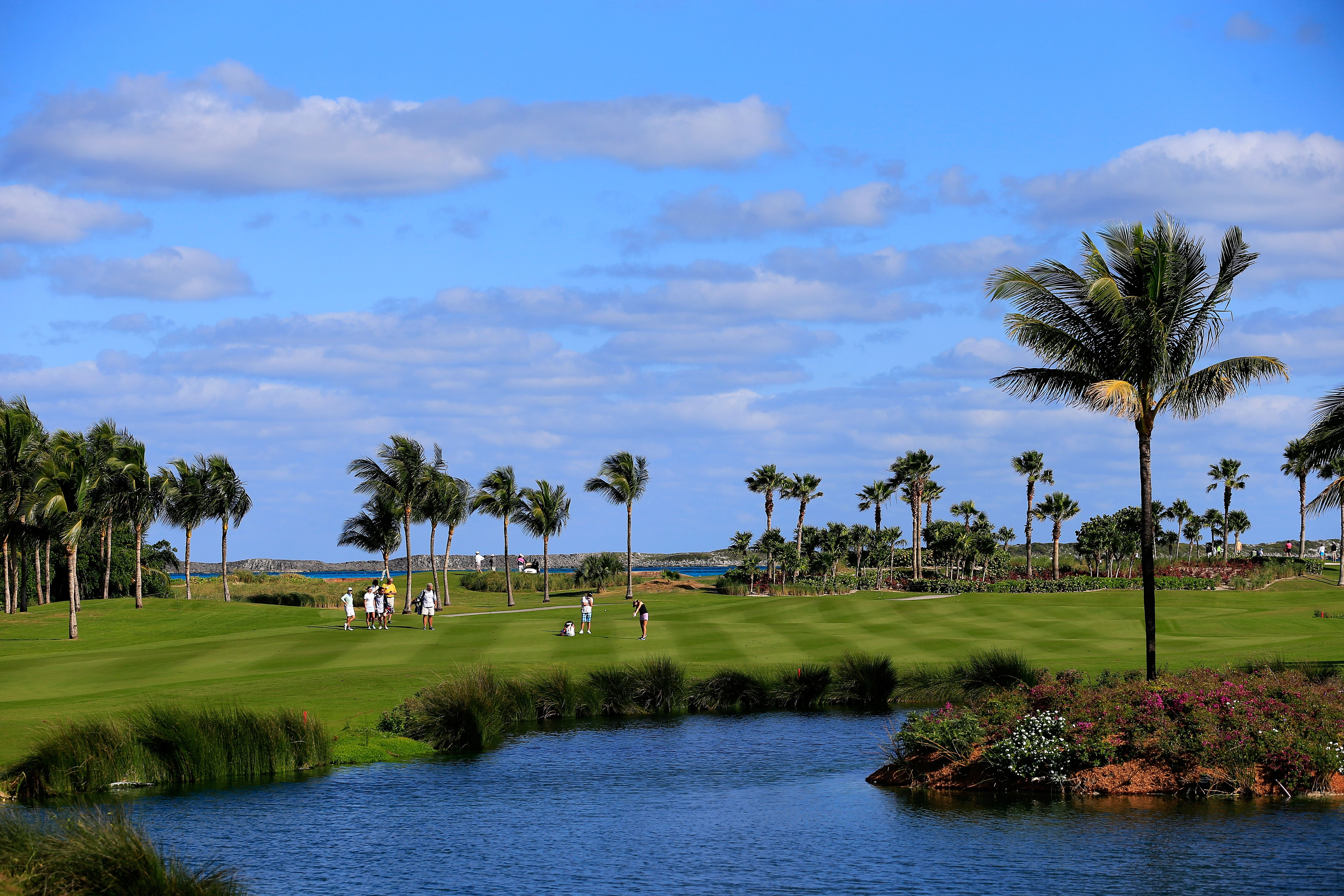 Golfers plays the ninth hole during round one of the Pure Silk Bahamas LPGA Classic at the Ocean Club course in Paradise Island, Bahamas.