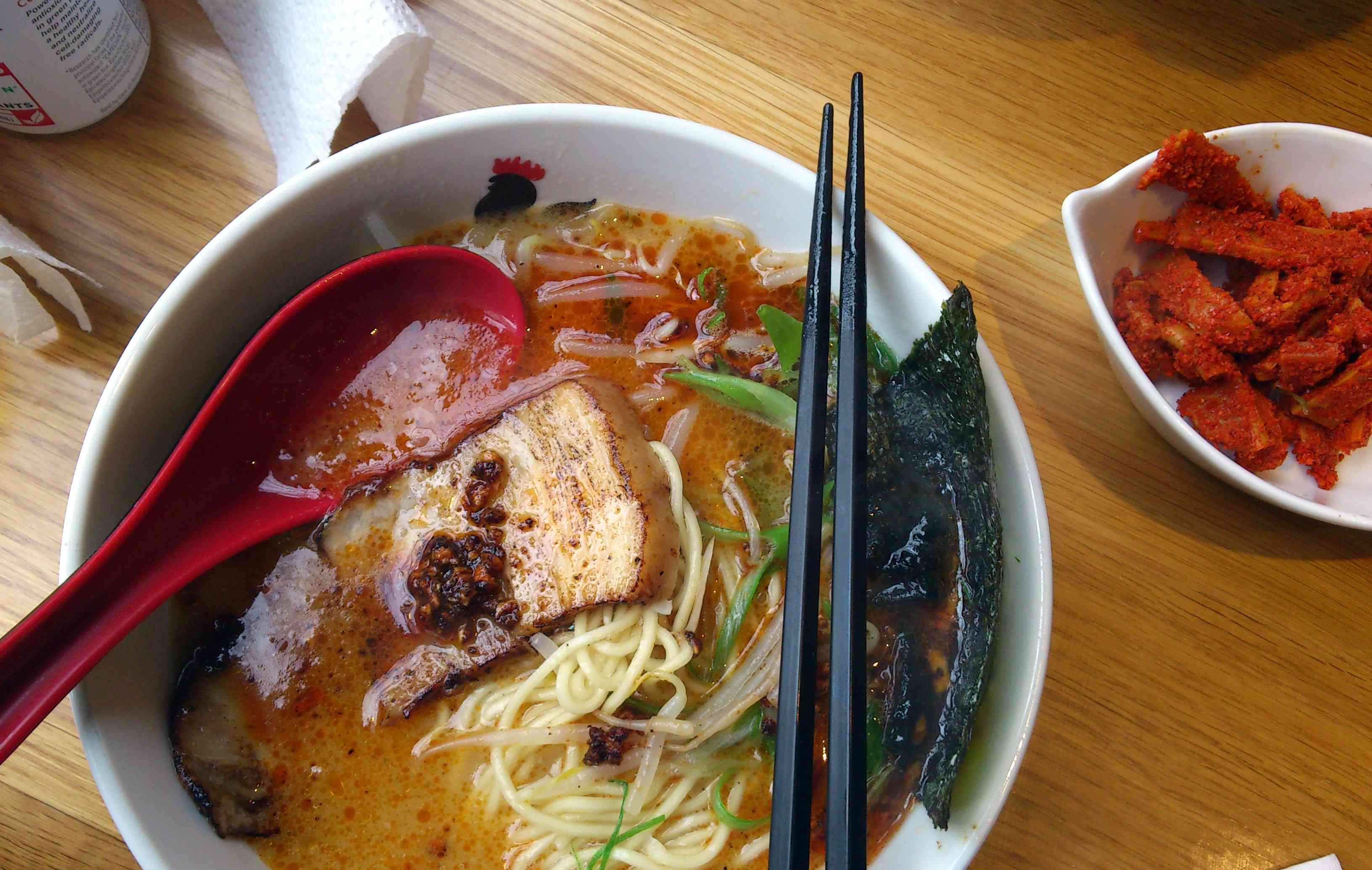 spicy ramen from Totto Ramen with seaweed scallions and pork belly
