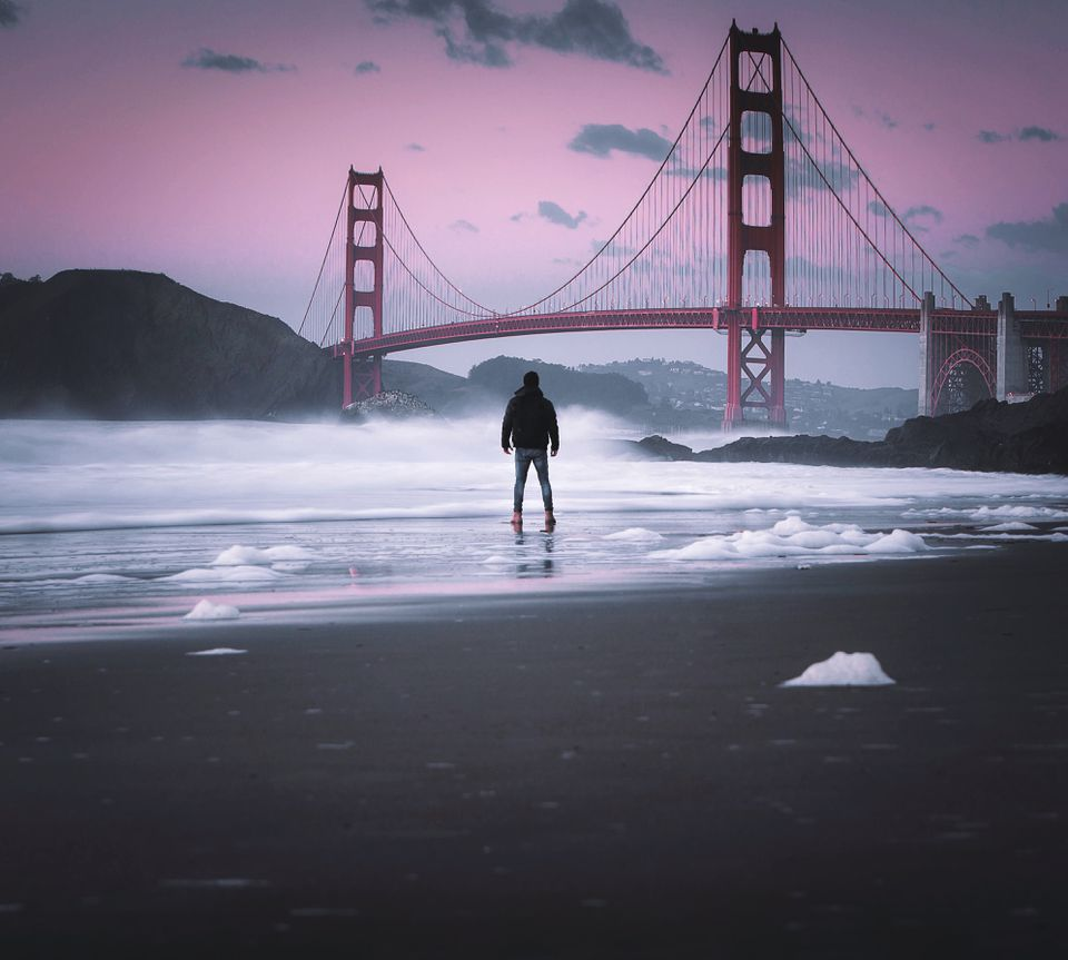 Man Standing On San Francisco Beach Against Sky
