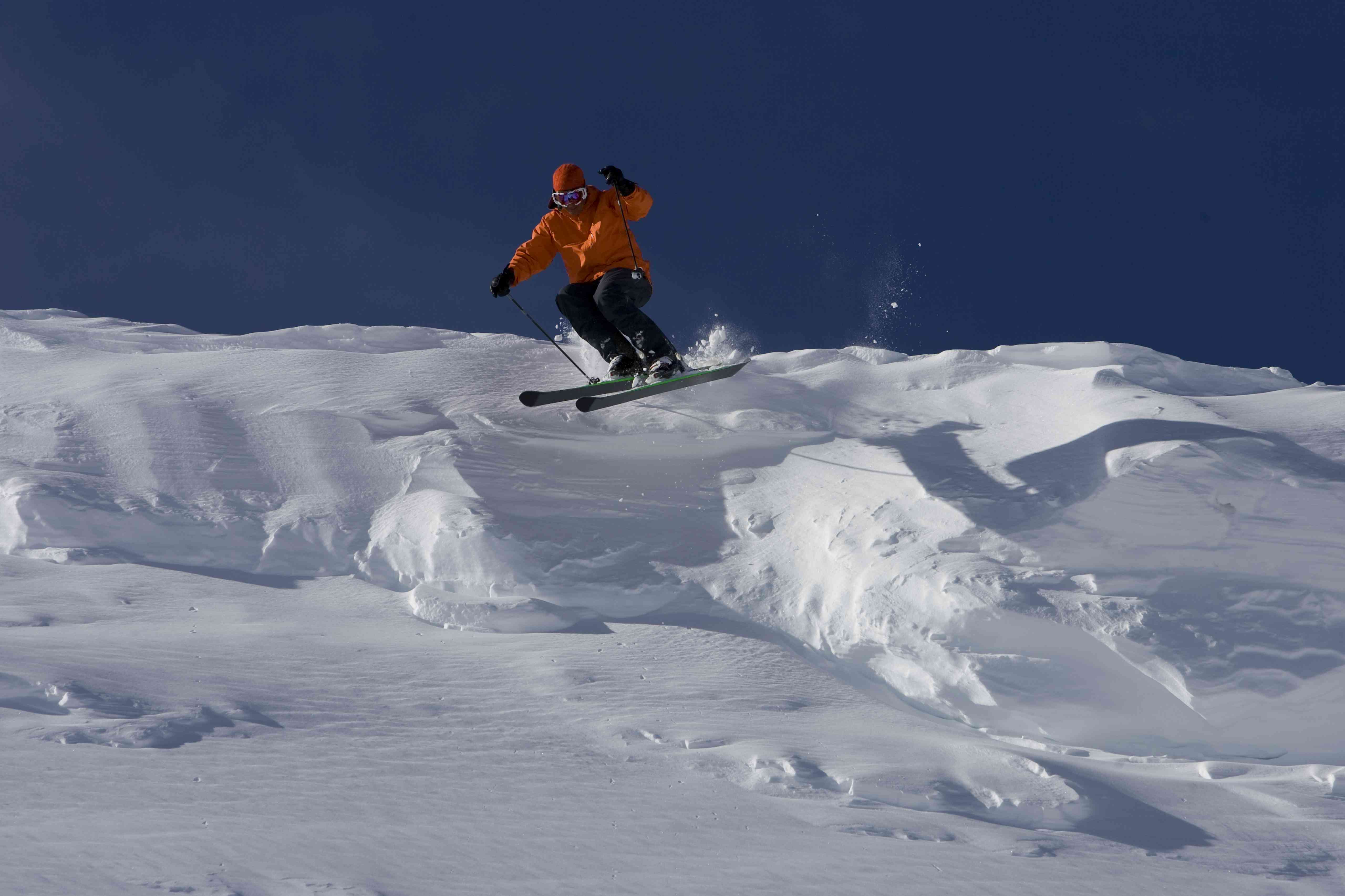 Kirkwood Mountain Resort, California: A man skis in fresh, deep powder on a sunny day at a mountain resort in California.