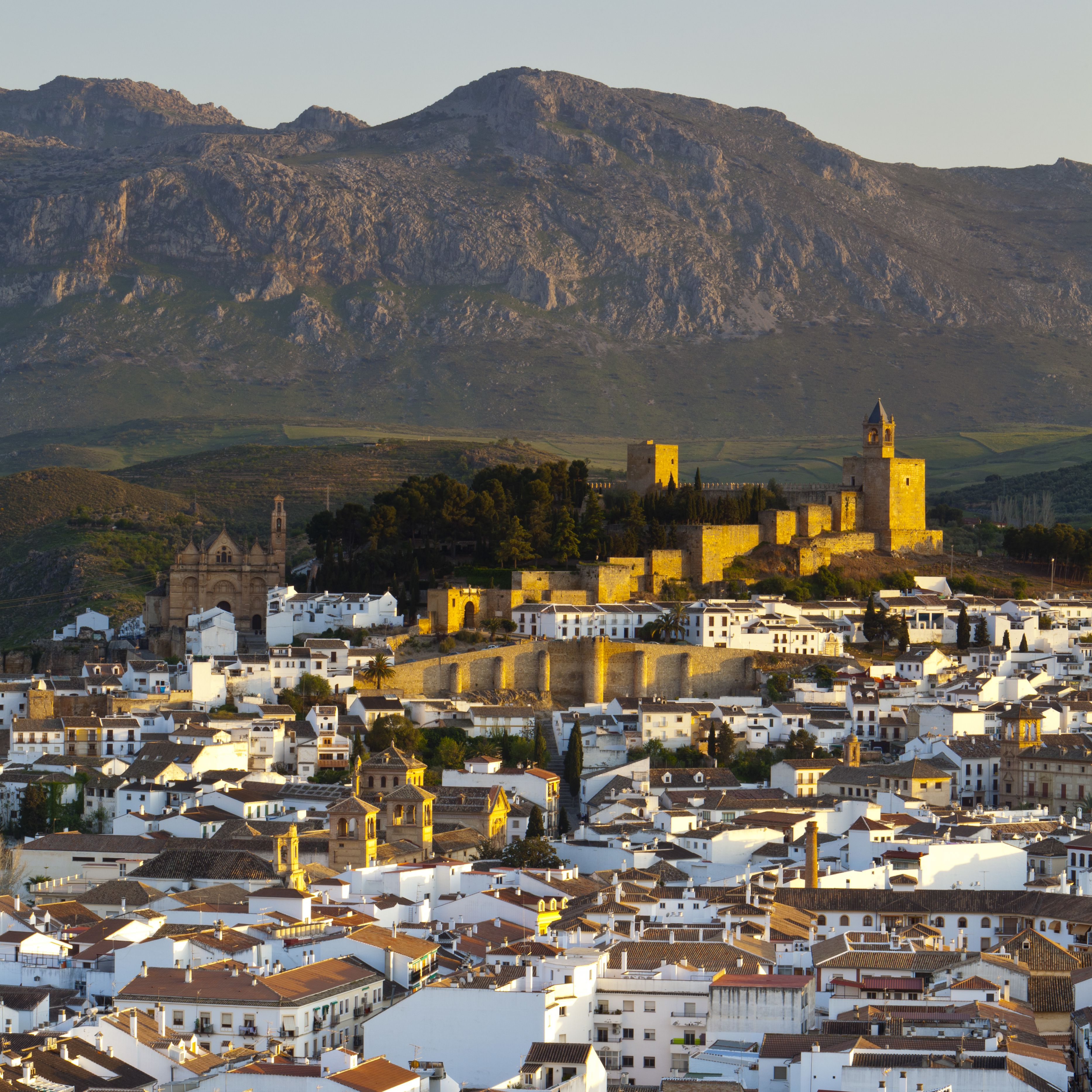Moorish Alcazaba (castle) & city overview at sunset, Antequera, Malaga Province, Andalusia, Spain
