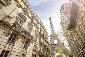 Looking up at The Eiffel Tower through Paris housing, Paris, France