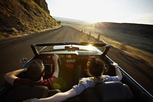 Couple road tripping at sunset