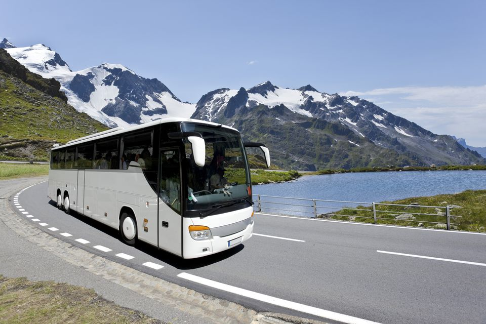 White bus crossing the Alps