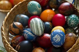 Close-Up Of Colorful Easter Eggs In Basket