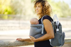 Woman with baby and diaper bag
