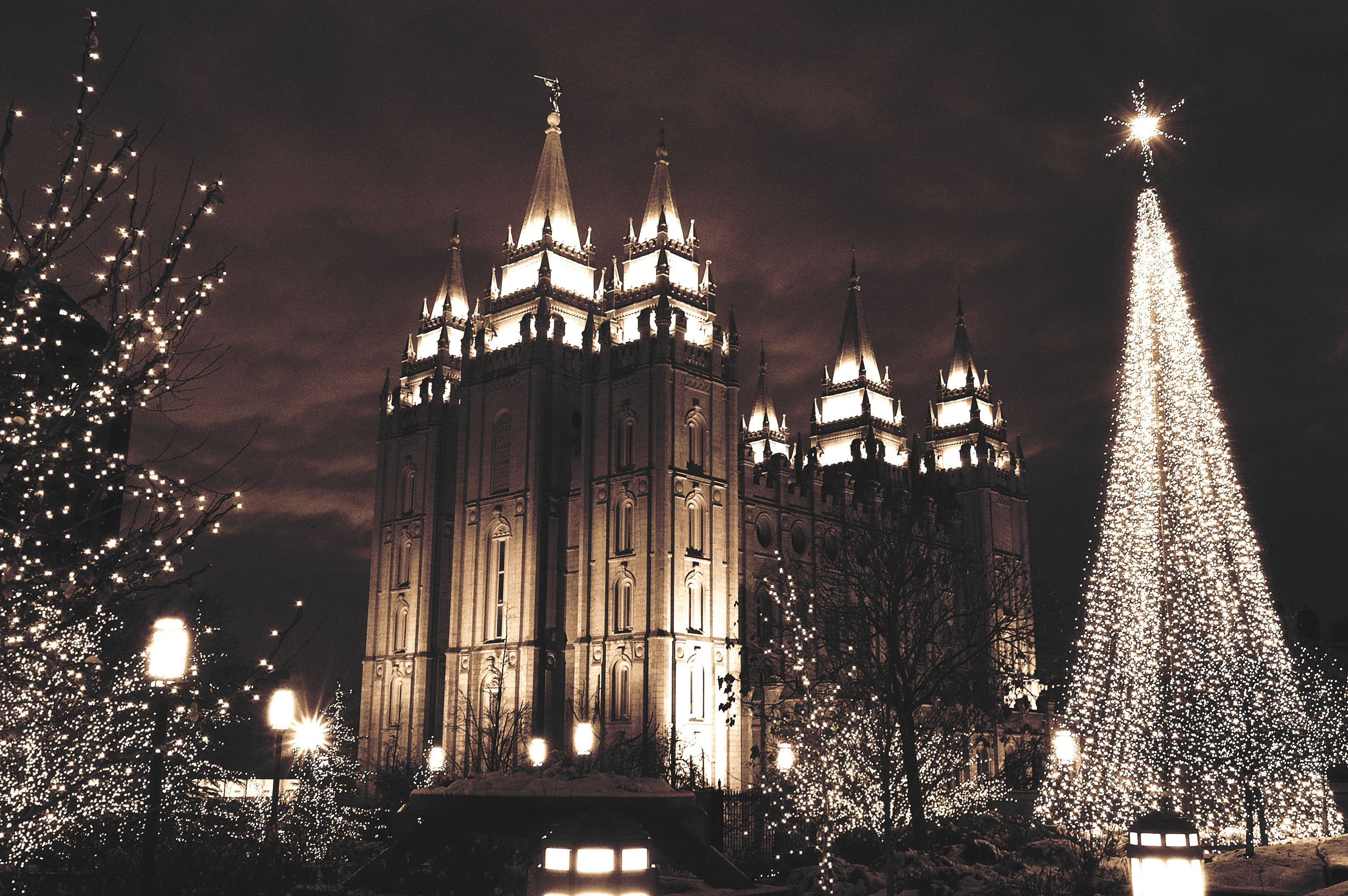 Temple Square and downtown Salt Lake City covered in holiday lights at night