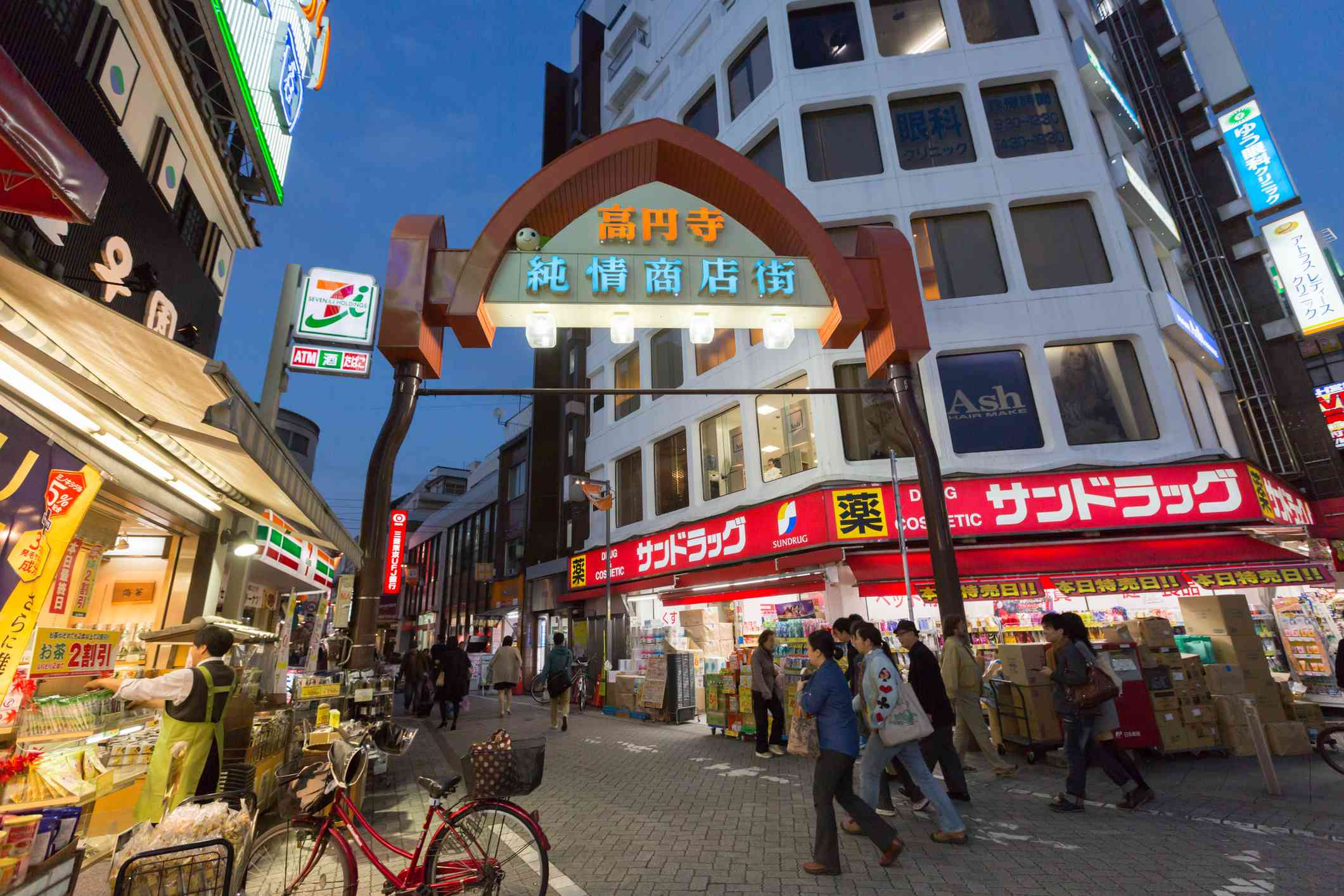 People walk past the Koenji Junjo Shopping Street in Tokyo, Japan.