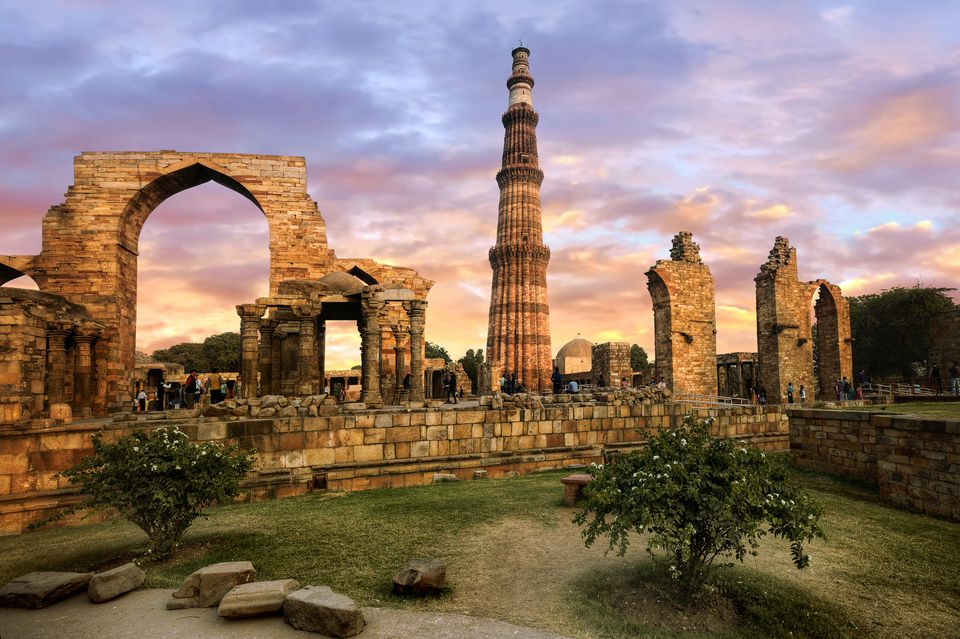 View of Qutub Minar and the Ruins of Qubbat-ul-Islam (Dome of Islam) Mosque in Qutb Complex, Mehrauli, Delhi, India