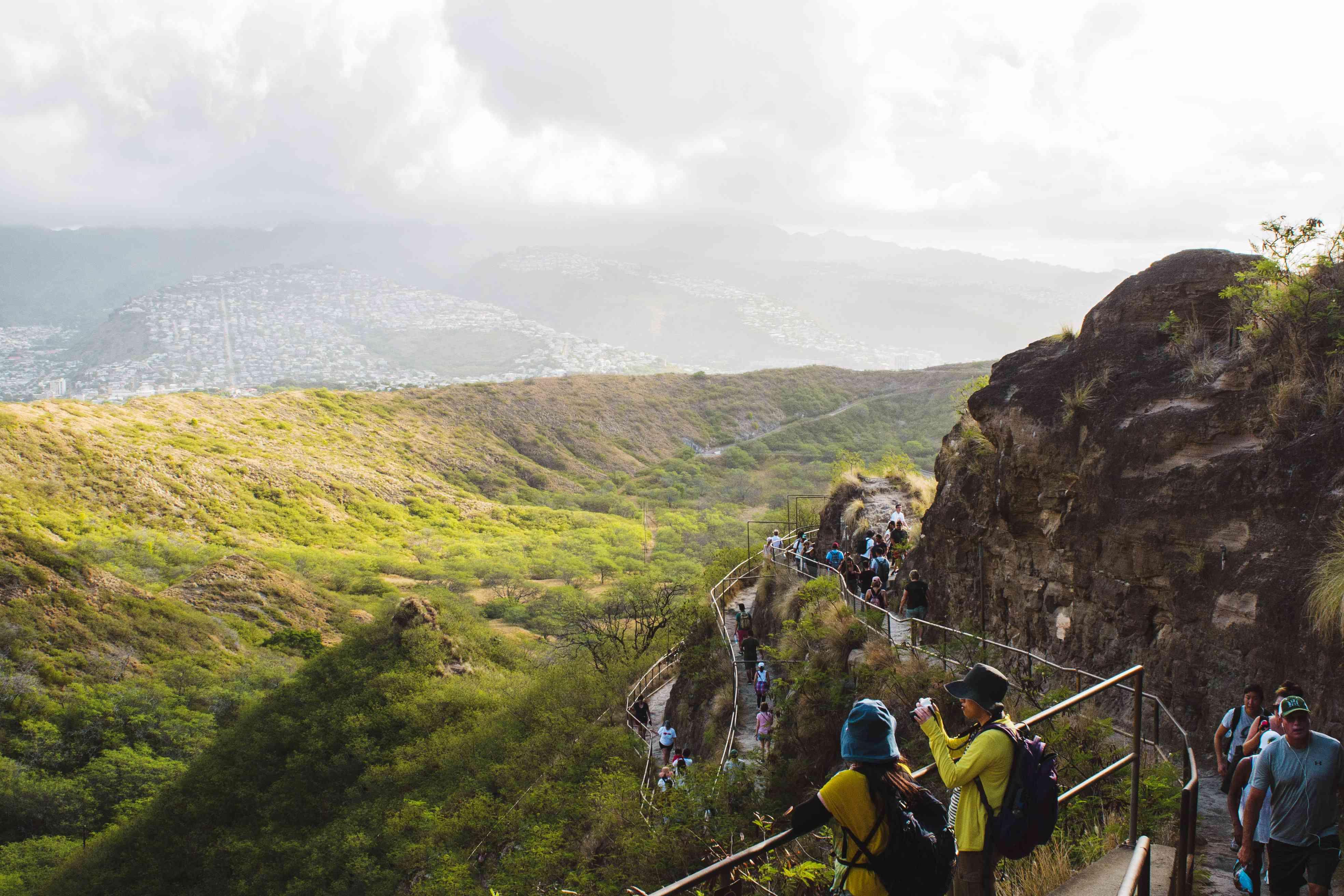 People hiking up Diamond Head