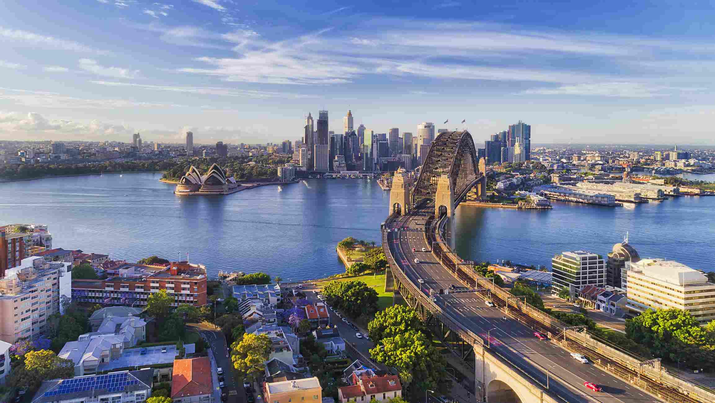 Sydney Harbour bridge across Sydney harbour towards city