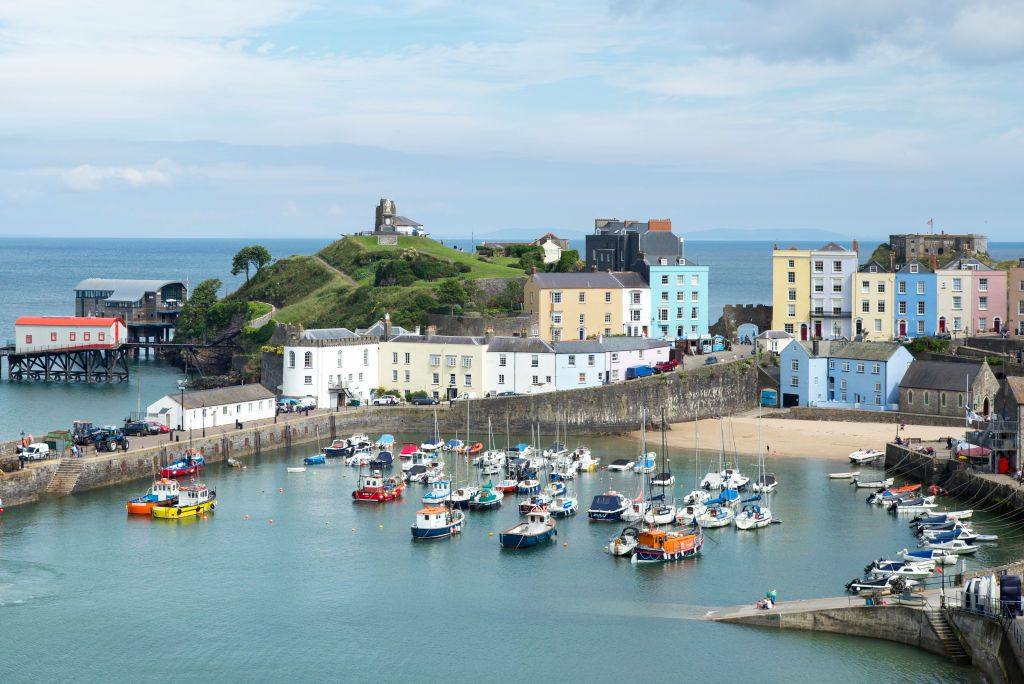 Colorful houses and boats in a harbor below in Tenby, Wales