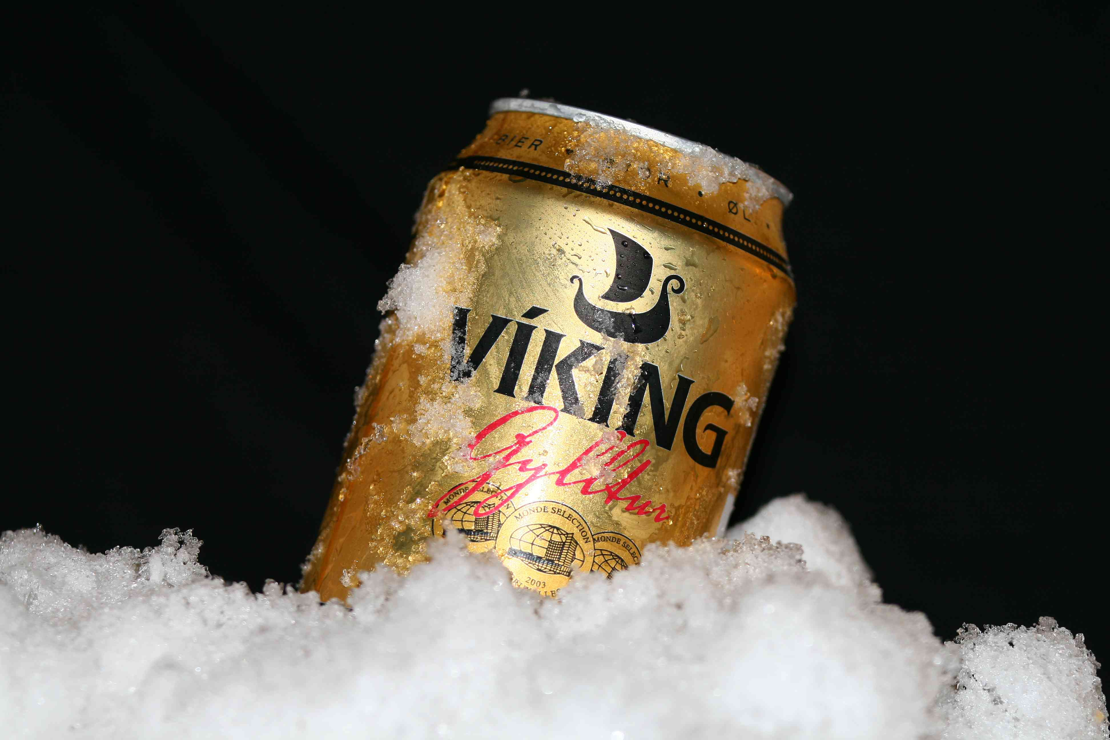 Can of viking gold beer half-buried in shaved ice